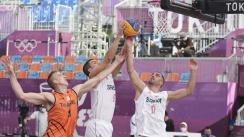 epa09361270 Ross Bekkering (L) of the Netherlands in action against Dusan Domovic Bulut (R) and Minhailo Vasic (C) of Serbia during the Men's Pool Round match between the Netherlands and Serbia in the 3x3 Basketball events of the Tokyo 2020 Olympic Games