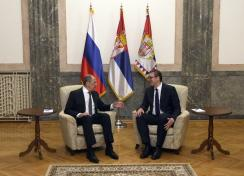 Russian Foreign Minister Sergey Lavrov, left, speaks with Serbia's President Aleksandar Vucic in Belgrade, Serbia, Sunday, Oct. 10, 2021. Lavrov arrives in Serbia on the occasion of the summit of the Non-Aligned Movement. (AP Photo/Darko Vojinovic)