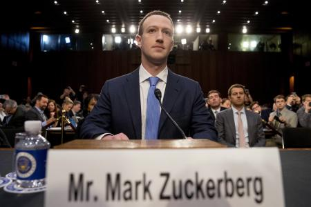 FILE - In this Tuesday, April 10, 2018 file photo, Facebook CEO Mark Zuckerberg arrives to testify before a joint hearing of the Commerce and Judiciary Committees on Capitol Hill in Washington. Holocaust survivors around the world are lending their voices